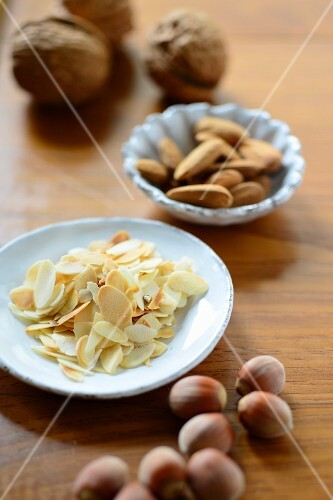 An arrangement of flaked almonds, whole almonds, walnuts and hazelnuts