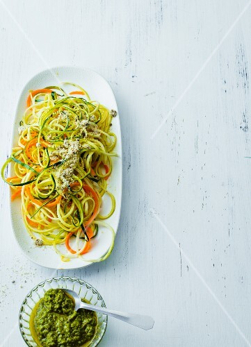 Vegetable spaghetti with vegan Parmesan made from hemp seeds and cashew nuts