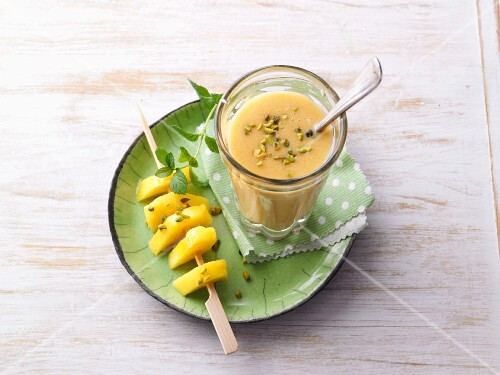 Oat and mango breakfast with pistachio nuts