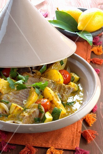 Tuna fish with potatoes, courgettes and tomatoes in a tagine