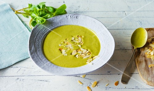 Purslane and courgette soup with almond mousse