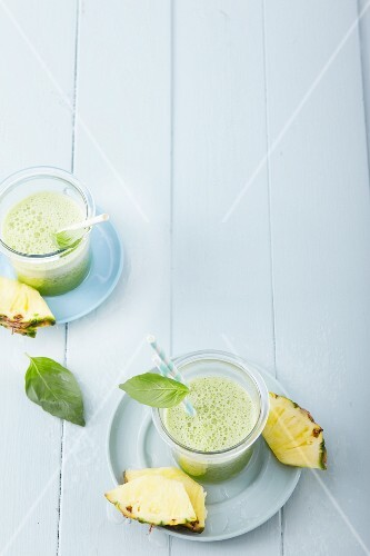 Pineapple and stinging nettle smoothies with coconut water and basil