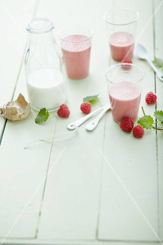 Raspberry smoothies with milk and ground ivy