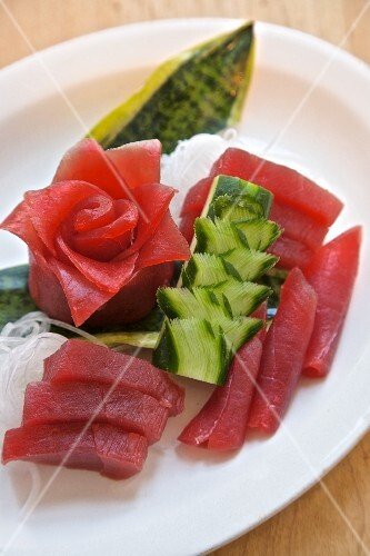 Tuna sashimi with artistically cut daikon radish and cucumber