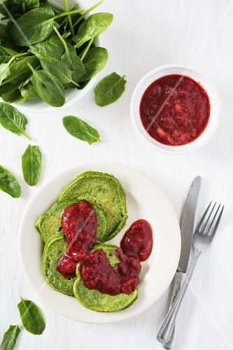 Sweet spinach pancakes with strawberry sauce