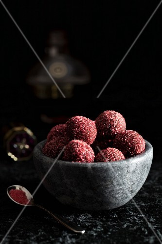 Raspberry truffles rolled in coloured sugar