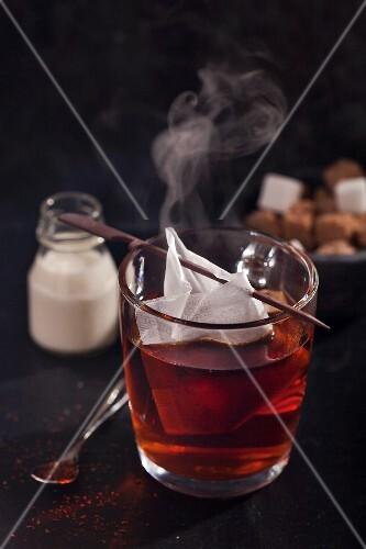 A steaming mug of redbush tea with a teabag