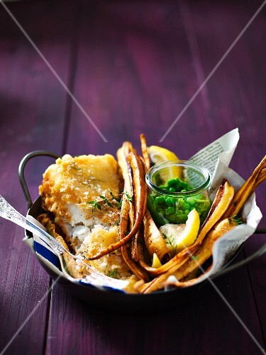 Fish in a tempura and cidre batter with parsnip crisps and mushy peas