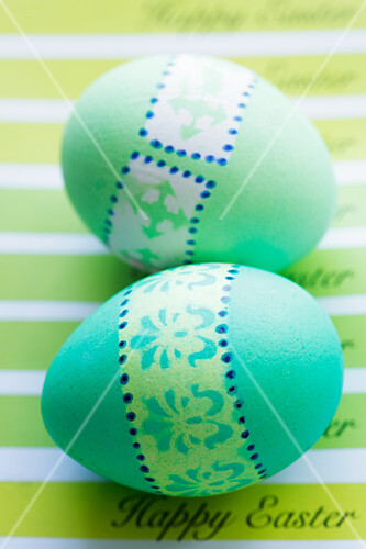 Green Easter eggs on an Easter card