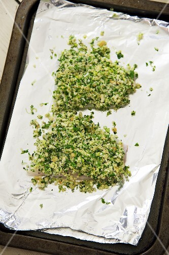 Cod with a horseradish and herb crust being prepared