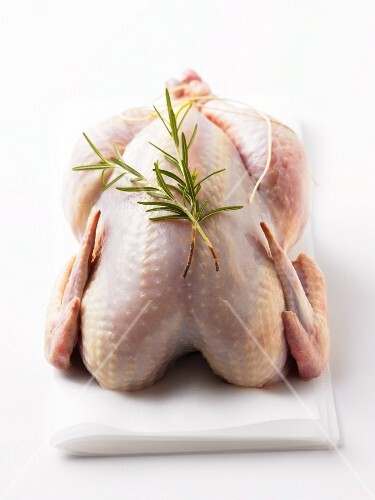 Whole Raw Chicken with Rosemary Sprigs