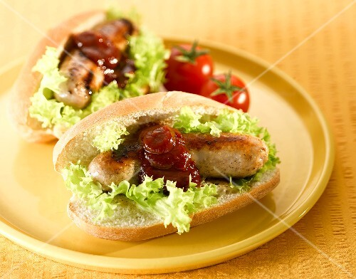 A sausage sandwich with barbecue sauce