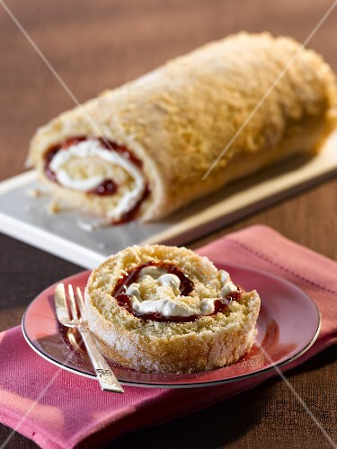 A Swiss roll filled with cream and jam