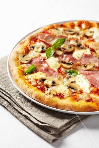A ham and mushroom pizza