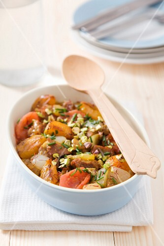 Lamb tajine with apricots, tomatoes, onions and pistachios