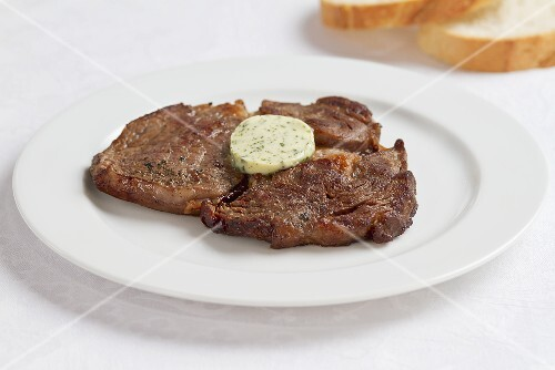 Fried steaks with herb butter