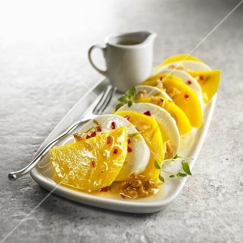 Mango mozzarella carpaccio with walnuts and chilli