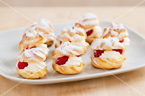 Profiteroles filled with cream and raspberries