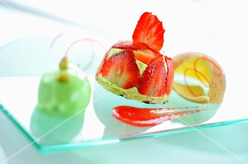 A strawberry tartlet with pistachio ice cream