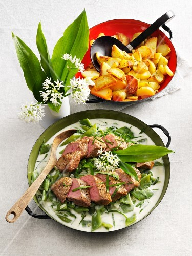 Saddle of lamb on a ramson and bean medley with fried potatoes
