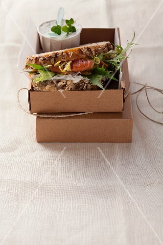 An organic smoked salmon and bean sprouts cream sandwich on wholemeal bread