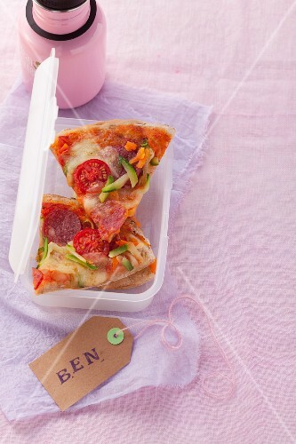 Potato pizza with vegetables, mozzarella and salami