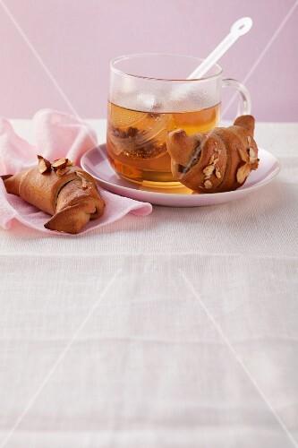 Nut croissants with tea
