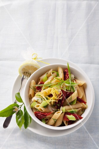 Penne pasta with dried tomatoes and spring onions