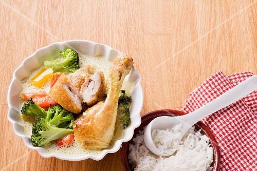 Chicken leg braised in coconut milk served with vegetables and rice