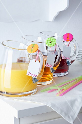 Jugs of juice with buttons and name tags