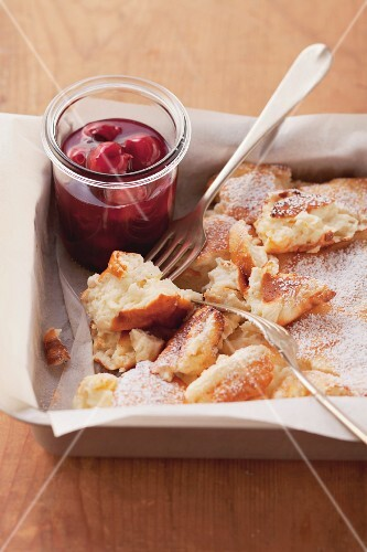 Shredded quark and semolina pancakes with cherry compote