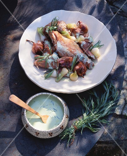 Rabbit with garlic, spring onions and tarragon sauce
