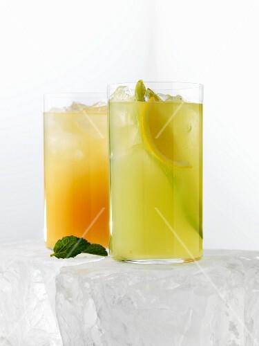 Two citrus fruit drinks