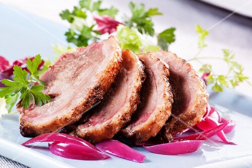 Roast goose with red onions