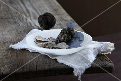 Black summer truffles, whole and sliced