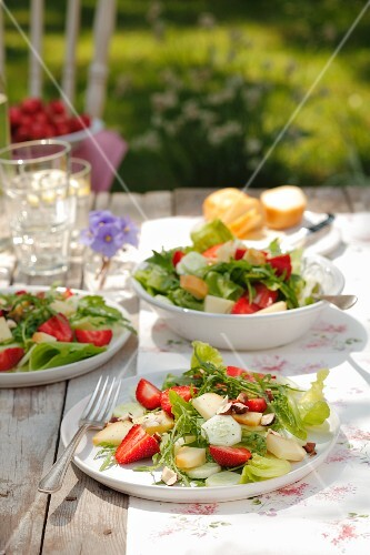 Mixed leaf salad with strawberries, cucumber, smoked sheep's cheese and hazelnuts
