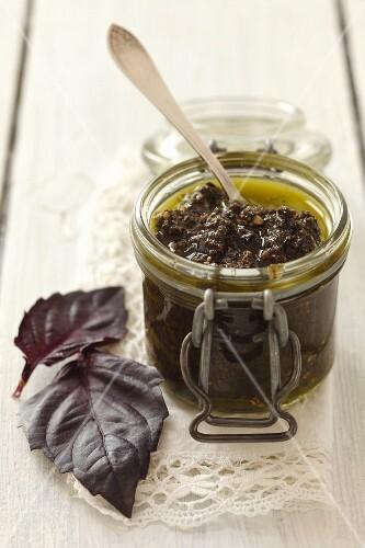 A jar of purple basil pesto