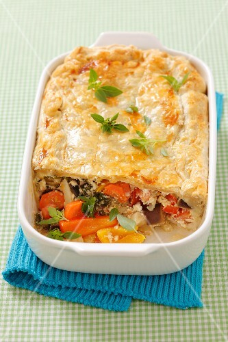 A vegetable quark bake with a puff pastry lid