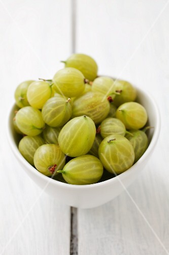 A bowl of green gooseberries