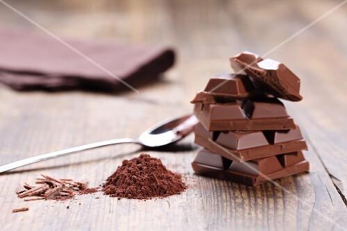 Stacked milk chocolate, cocoa powder, chocolate shavings