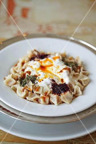 Manti (Turkish tortellini) with yogurt sauce