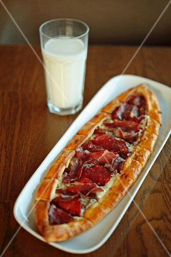 Pide (Turkish flatbread) with air-dried ham