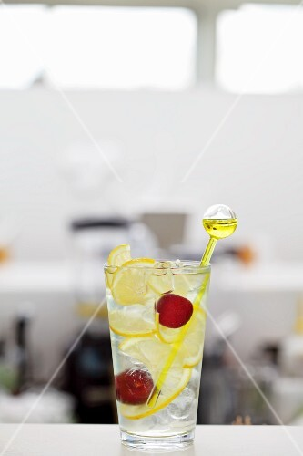 Vodka and lemonade with cherries