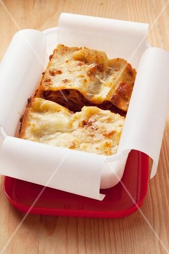 Lasagne stored in a plastic box