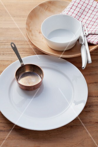 An empty place setting with a saucier