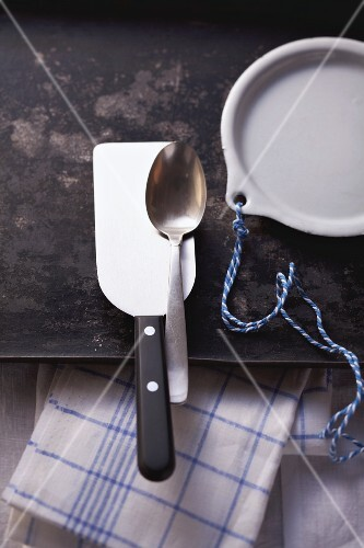 Kitchen utensils on a baking tray