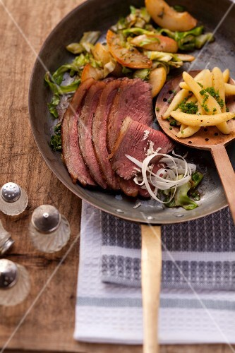 Prime boiled beef with pointed cabbage, pears and potato orzo pasta