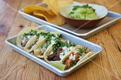 Various tacos with guacamole and tortilla chips (Mexico)