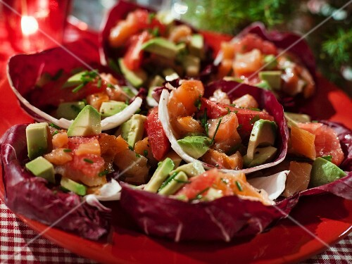 Salmon tartare with grapefruit and avocado on radicchio leaves