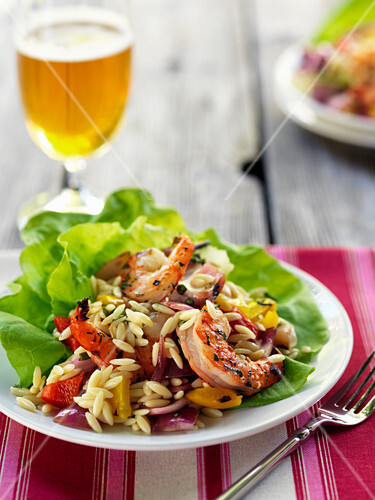 Pasta salad with vegetables and prawns